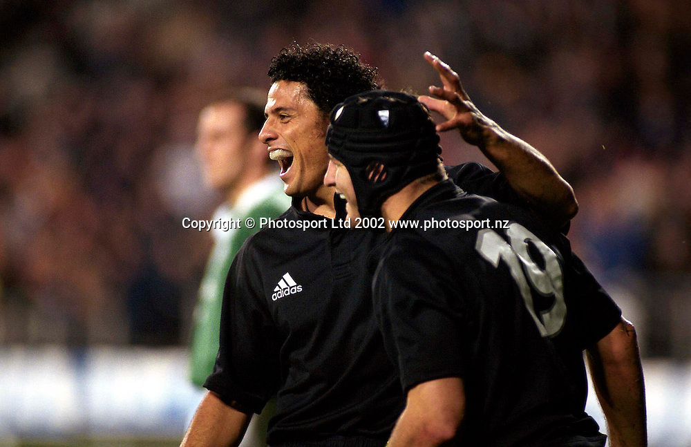 Doug Howlett and Marty Holah during the rugby union match between the All Blacks and Ireland, Eden Park, Auckland, 22 June, 2002. Photo: PHOTOSPORT