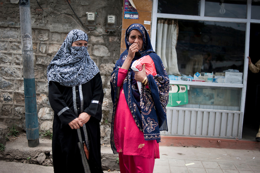 Women stand in the street of a commercial district of Abbottabad, Khyber Pakhtunkhwa province, Pakistan on May 5, 2011. US special forces laucnhed an agressive attack on the compound early morning on May 2 killing Osama bin Laden.
