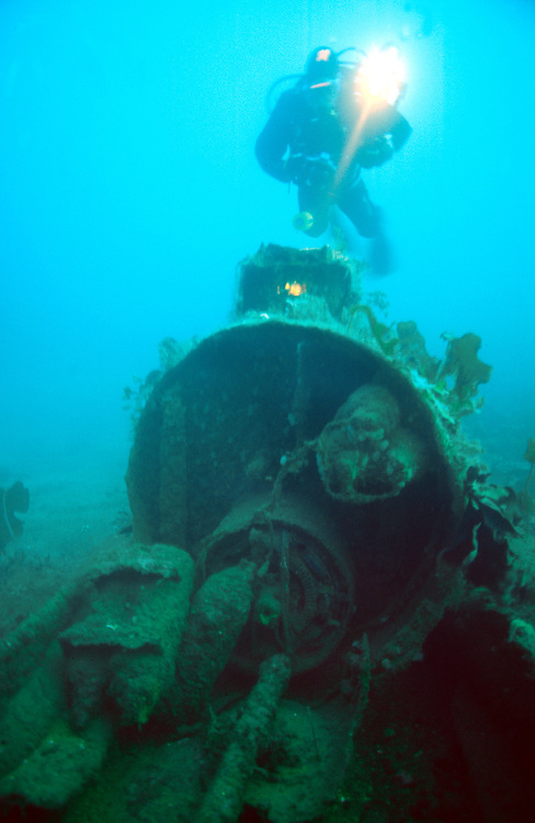 Molch midget submarine. The submarine has been splitted into two parts. Here is a diver lokking at the engine. Location: Norway