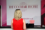 Racegoer awaiting an early cocktail at the York Dante Meeting at York Racecourse, York, United Kingdom on 17 May 2018. Picture by Mick Atkins.