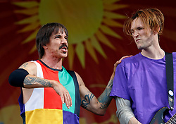 24 April 2016. New Orleans, Louisiana.<br /> The New Orleans Jazz and Heritage Festival. <br /> Anthony Kiedis (l) and John Klinghoffer of the Red Hot Chill Peppers headlines the Acura Stage.<br /> Photo; Charlie Varley/varleypix.com