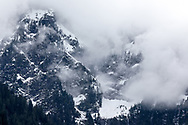 Mount Blandshard (The Golden Ears) briefly shows through the clouds in Golden Ears Provincial Park.  Photographed in Maple Ridge, British Columbia, Canada.