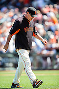 Bruce Bochy is returning to the dugout after giving the ball to a reliever during the MLB game between the San Francisco Giants and the San Diego Padres, at AT&amp;T Park in San Francisco, CA.<br /> The Giants won 13-8 in 9 innings.<br /> Credit : Glenn Gervot