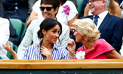 The Duchess of Sussex and Gill Brook (right) in the royal box on centre court on day twelve of the Wimbledon Championships at the All England Lawn Tennis and Croquet Club, Wimbledon. PRESS ASSOCIATION Photo. Picture date: Saturday July 14, 2018. See PA story TENNIS Wimbledon. Photo credit should read: Nic Bothma/PA Wire. RESTRICTIONS: Editorial use only. No commercial use without prior written consent of the AELTC. Still image use only - no moving images to emulate broadcast. No superimposing or removal of sponsor/ad logos. Call +44 (0)1158 447447 for further information.