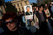 Scenes from Belgrade, Serbia. Serb Nationalist Protest against US/UN and arguing for Kosovo as part of Serbia. Pensioner holding sign of wanted war-criminal Radovan Karadzic.