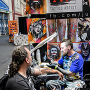 Juzek Ink Tattoo artist tattoo a client at The Great British Tattoo Show, London, UK