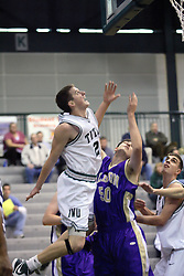30 December 2006: Jordan Morris watches his shot. Evan Way was unable to get the block. The Titans outscored the Britons by a score of 94-80. The Britons of Albion College visited the Illinois Wesleyan Titans at the Shirk Center in Bloomington Illinois.<br />