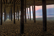 Pismo Beach, California. Underneath the pier at sunset