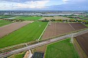 Nederland, Zuid-Holland, Gemeente Strijen, 23-10-2013l; hogesnelheidstrein Thalys op HSL-spoor doorkruist de Hoeksche Waard, onderweg naar Rotterdam CS. Water van de Dortsche Kil aan de horizon.<br /> Thalys high-speed train on HSL track crosses the Hoekschewaard, en route to Rotterdam Centra Station. Water Dortsche Kil on the horizon.<br /> luchtfoto (toeslag op standard tarieven);<br /> aerial photo (additional fee required);<br /> copyright foto/photo Siebe Swart