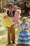 Father with daughters at the annual ?Feria? in Jerez de la Frontera.
