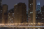 One of the most well-known streets in the US, Lake Shore Drive hugs the Lake Michigan shore through the city of Chicago. Here, cars stream down the road late on a winter night, enjoying the view of the city and the lake.