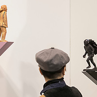Visitor looks at 'Man Turns Away, 2016' (L) and 'Man flees the spectacle, 2016' (R) by artist Clive van den Berg at Art Basel Hong Kong 2017 on 23 March 2017, in Hong Kong Convention and Exhibition Centre, Hong Kong, China. Photo by Chris Wong / studioEAST