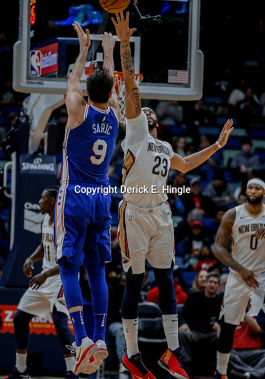 Dec 10, 2017; New Orleans, LA, USA; Philadelphia 76ers forward Dario Saric (9) shoots over New Orleans Pelicans forward Anthony Davis (23) during the first quarter of a game at the Smoothie King Center. Mandatory Credit: Derick E. Hingle-USA TODAY Sports