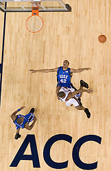 Duke's Lance Thomas (42) plunges into the lane as Virginia's Sean Singletary (44) completes a behind the back pass.  The University of Virginia Cavaliers beat the #8 ranked Duke University Blue Devils 68-66 in overtime at the John Paul Jones Arena in Charlottesville, VA on February 1, 2007...
