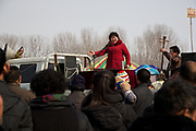 Performers play to the crowds at the traditional Ma Jie storytelling festival in Henan province, China.<br /> <br /> Farmers in Henan have for centuries gathered during the Chinese New Year in the wheat fields to listen to bards singing and recounting old tales. <br /> <br /> Performers come from all over China. Those who are successful will be booked during the festival to perform in nearby villages. <br /> <br /> The stories are usually accompanied by music, played by the storyteller or by a musician.