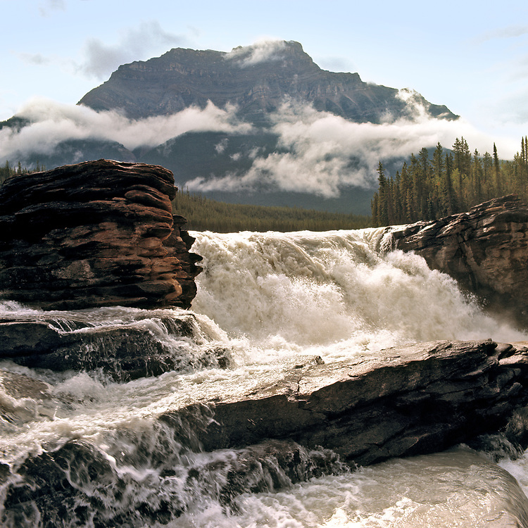 The Athabasca River shoots through Athabasca Falls in Jasper N. P., Alberta, Canada. ©Ric Ergenbright