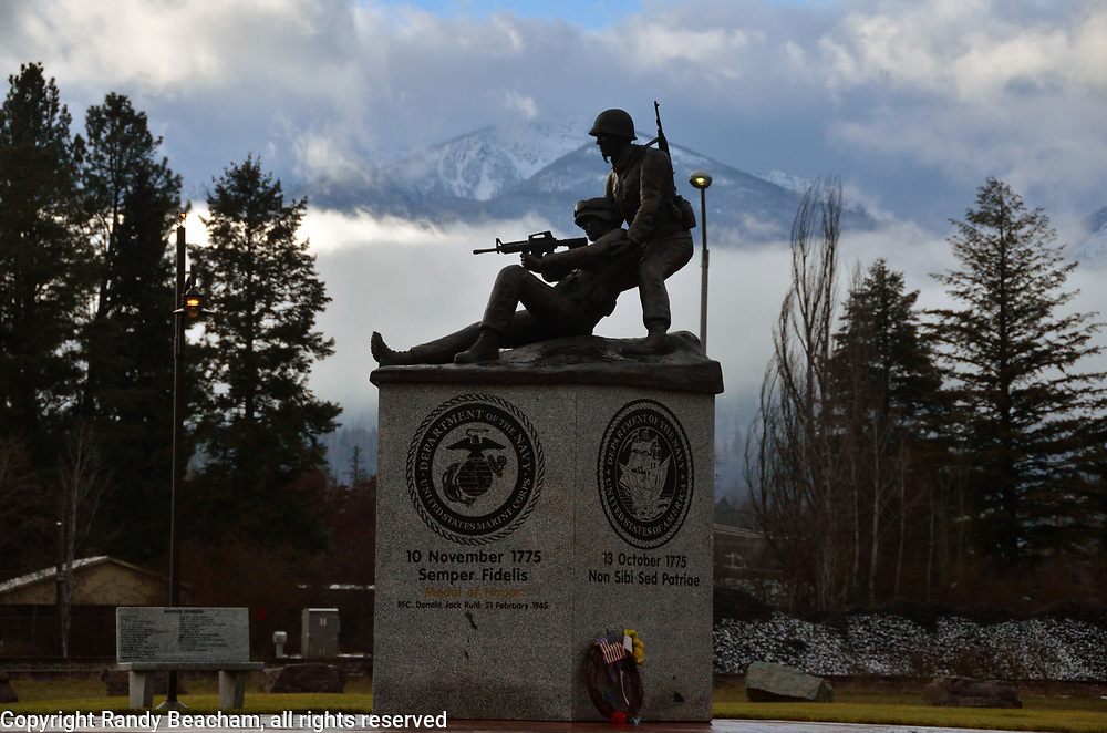 Lincoln County Veterans Memorial below the Cabinet Mountains in Libby. Sculpture created by Scott Lennard. Lincoln Country, northwest Montana.