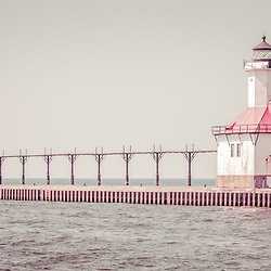 Saint Joseph Lighthouse retro panorama picture. The St. Joseph Michigan Lighhouse and pier catwalk are a popular local attraction. The photo is high resolution and was taken in 2013. Panoramic ratio is 1:3.