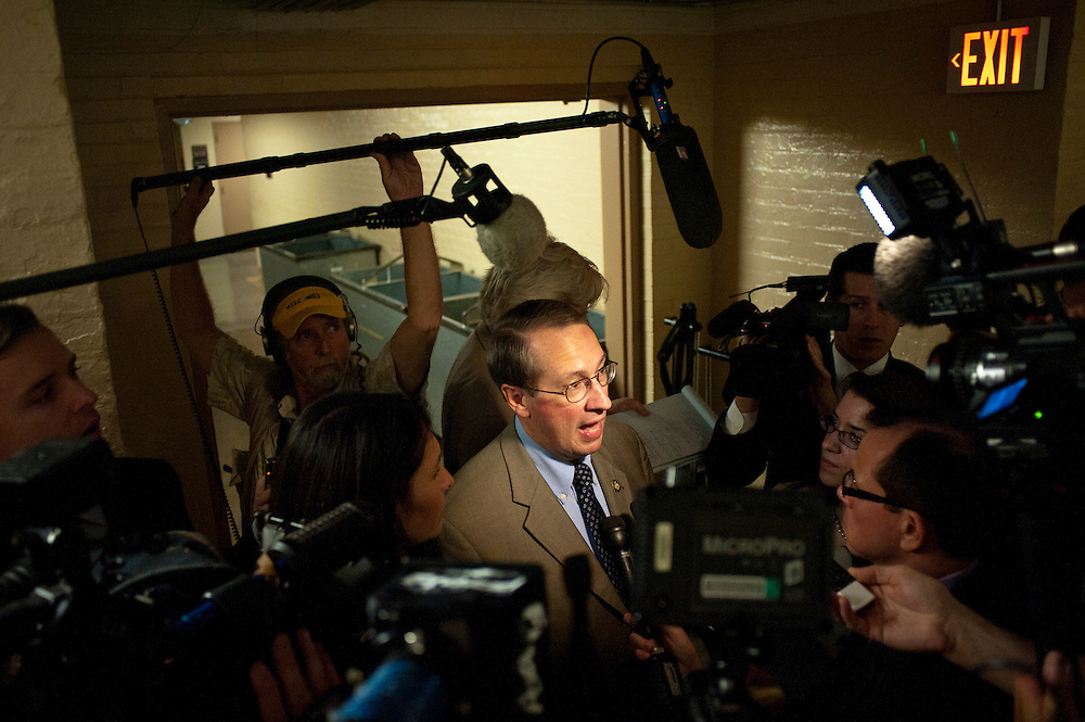 Rep. BOB GOODLATTE (R-VA) is questioned by reporters as he leaves a House Conference meeting at the U.S. Capitol on Wednesday as they continue negotiations on raising the debt ceiling.