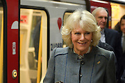 © Licensed to London News Pictures. 30/01/2013. London, UK Their Royal Highnesses arrive at Kings Cross St Pancras, after travelling on a tube train.  HRH The Prince of Wales and HRH The Duchess of Cornwall visit Farringdon Station in London today 30th January 2013. They were carrying out engagements to celebrate London Underground's 150th anniversary.]. Photo credit : Stephen Simpson/LNP