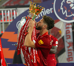 LIVERPOOL, ENGLAND - Wednesday, July 22, 2020: Liverpool's Adam Lallana kisses the Premier League trophy as the Reds are crowned Champions after the FA Premier League match between Liverpool FC and Chelsea FC at Anfield. The game was played behind closed doors due to the UK government's social distancing laws during the Coronavirus COVID-19 Pandemic. (Pic by David Rawcliffe/Propaganda)