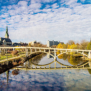 The speed river downtown Guelph, with the Heffernan street footbridge and St. George's Church.  Photo by Andrew Goodwin