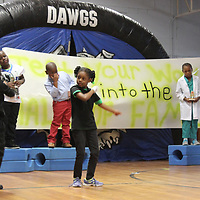 Aberdeen Elementary School first-graders perform a routine as part of a pep rally for the school's third-graders ahead of the Third-Grade Reading Gate assessment. Students in each grade gave performances to encourage students for state testing.