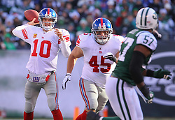 Dec 24, 2011; East Rutherford, NJ, USA; New York Giants quarterback Eli Manning (10) throws a pass during the first half of their game against the New York Jets at MetLife Stadium.