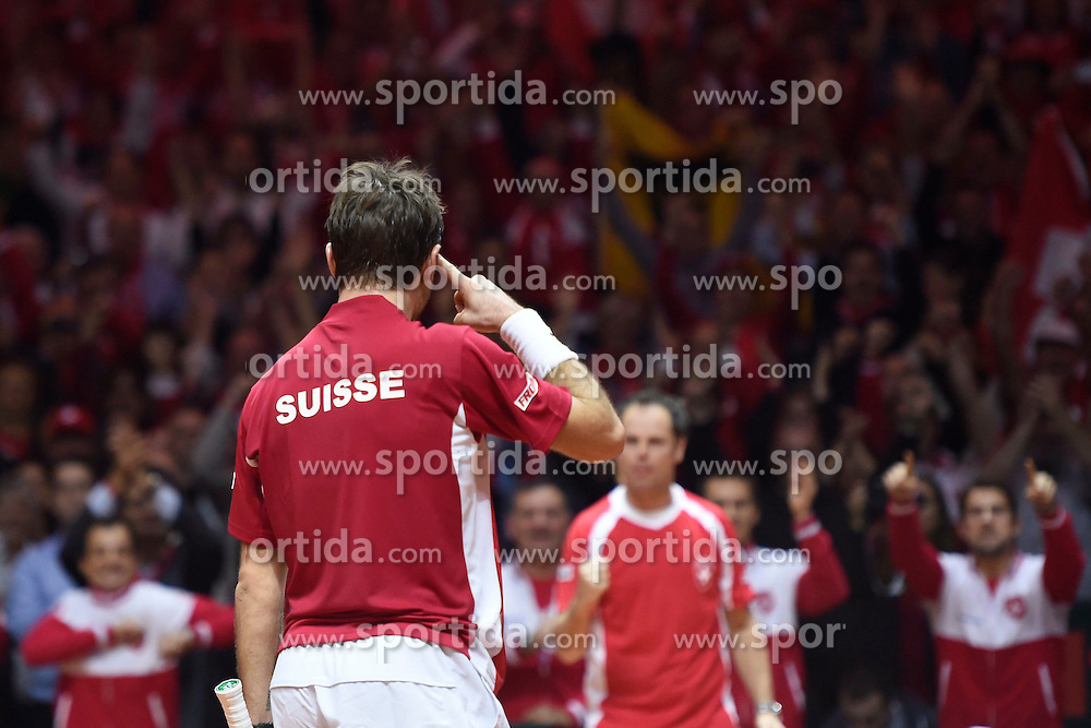 21.11.2014, Stade Pierre Mauroy, Lille, FRA, Davis Cup Finale, Frankreich vs Schweiz, im Bild Stanislas Wawrinka (SUI) jubelt nach dem Matchball // during the Davis Cup Final between France and Switzerland at the Stade Pierre Mauroy in Lille, France on 2014/11/21. EXPA Pictures &copy; 2014, PhotoCredit: EXPA/ Freshfocus/ Valeriano Di Domenico<br /> <br /> *****ATTENTION - for AUT, SLO, CRO, SRB, BIH, MAZ only*****