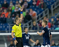 May 12, 2018 - Foxborough, Massachusetts, USA - Foxborough, Massachusetts - May 12, 2018: In a Major League Soccer (MLS) match, New England Revolution (blue/white) defeated Toronto FC (red), 3-2, at Gillette Stadium..Yellow Card: Scott Caldwell (Credit Image: © Andrew Katsampes/ISIPhotos via ZUMA Wire)