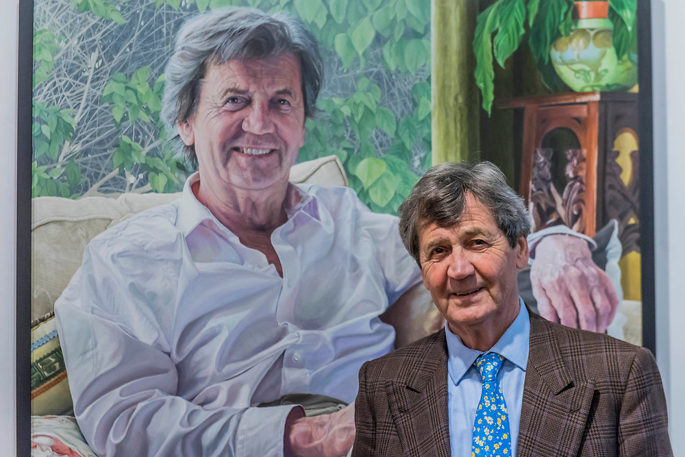 Lord Bragg with his portrait by David Vigor - The Royal Society of Portrait Painters Annual Exhibition at the Mall Galleries. It includes over 200 portraits by over 100 artists.