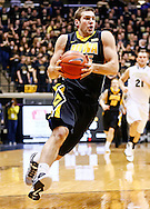 WEST LAFAYETTE, IN - JANUARY 27: Eric May #25 of the Iowa Hawkeyes brings the ball up court during the game against the Purdue Boilermakers at Mackey Arena on January 27, 2013 in West Lafayette, Indiana. Purdue defeated Iowa 65-62 in overtime. (Photo by Michael Hickey/Getty Images) *** Local Caption *** Eric May
