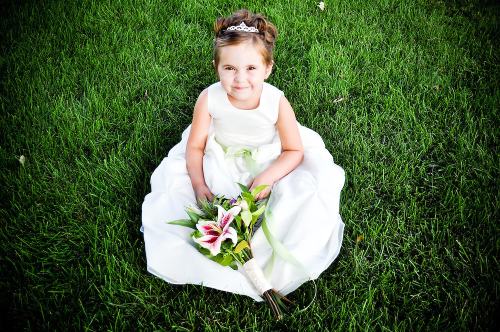 Michelle's flower girl plops down in the lush grass at St. Charles Country Club, St. Charles, IL