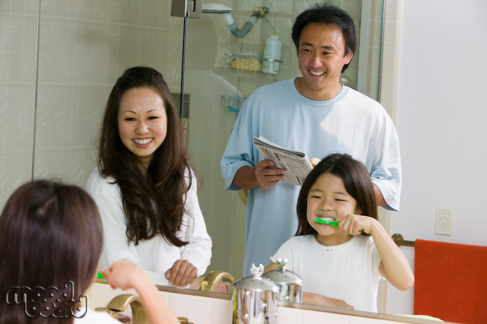 Family in Bathroom Getting Ready for Day