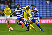 Ezgjan Alioski (10) of Leeds United goes down after being challenged by Lewis Baker (16) of Reading during the EFL Sky Bet Championship match between Reading and Leeds United at the Madejski Stadium, Reading, England on 12 March 2019.