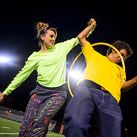 100213  Adron Gardner/Independent<br /> <br /> Gallup High School sophomore Jordon Deleeuw, left, slips a hoola hoop to Matt Mabrito in  the &quot;over, under&quot; contest during the class games at Public School Stadium Wednesday.
