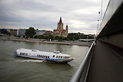 Danube and Mexiko-Kirche seen from the Reichsbruecke across the Danube. A Hungarian hydrofoil arriving from Budapest.