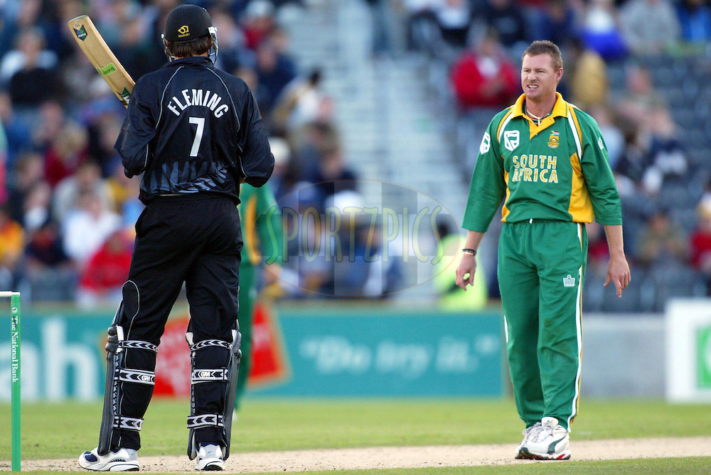 17 February 2004. New Zealand vs South Africa International one day cricket at Jade Stadium, Christchurch, New Zealand. Match 2 in series of 6..Stephen Fleming and Lance Klusener..Please credit: Andrew Cornaga/Photosport