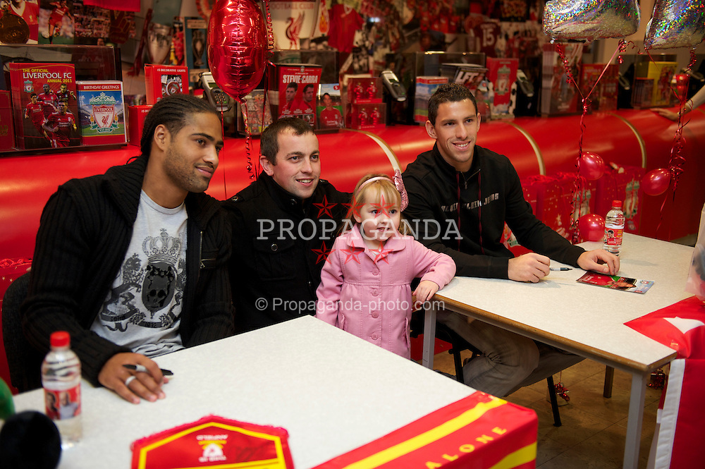 LIVERPOOL, ENGLAND - Friday, November 26, 2010: Liverpool's Glen Johnson and Maximiliano Ruben Maxi Rodriguez during a signing session for supporters at the Liverpool FC Club Shop at Anfield. (Photo by David Rawcliffe/Propaganda)