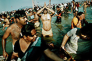 Khumb Mela, Hindu festival in Allahabad, India.<br /> Every morning the pilgrims take a bath in the cleansing waters.