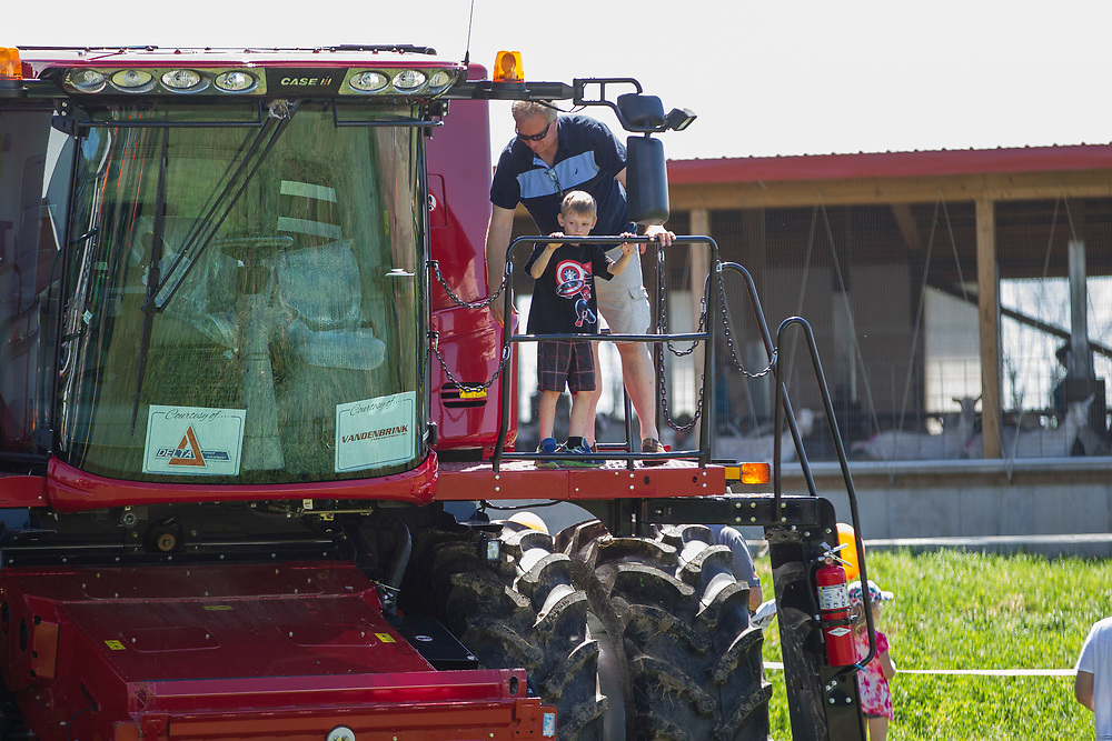 A kid looks out from a combine harvester during the Breakfast on the Farm event near Shedden, Ontario, Saturday, June 24, 2017.<br /> Farmers Forum/ Geoff Robins