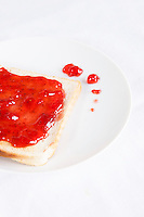 Close-up of jam spread on slice of bread