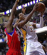 April 21, 2012; Indianapolis, IN, USA; Indiana Pacers small forward Danny Granger (33) shoots the ball against Philadelphia 76ers power forward Lavoy Allen (50) at Bankers Life Fieldhouse. Philadelphia defeated Indiana 109-106. Mandatory credit: Michael Hickey-US PRESSWIRE