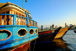 Traditional Dhows moored beside  The Creek river in Dubai United Arab Emirates UAE