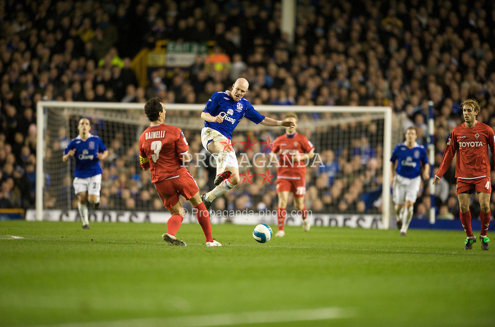 LIVERPOOL, ENGLAND - Wednesday, March 12, 2008: Everton's Andrew Johnson and ACF Fiorentina's Dario Dainelli during the UEFA Cup Round of 16 match at Goodison Park. (Photo by David Rawcliffe/Propaganda)