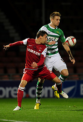Yeovil Town Byron Webster challenges for the ball with Leyton Orient's Gary Sawyer - Photo mandatory by-line: Dougie Allward/JMP - Tel: Mobile: 07966 386802 09/01/2013 - SPORT - FOOTBALL - Matchroom Stadium - London -  Leyton Orient v Yeovil Town - Johnstone's Paint Trophy Southern area semi-final.