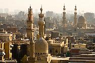 Egypt. Cairo elevated view.  - Ashraf Barsbay mosque and the minarets. Al Mu'izz Li din Allah street, bayn al Kasrayn area. View on the old islamic city, the minarets from the  of the madrasa and mausoleum An Nasir Muhammad Ibn Qualawun in Al Mu'izz street .  Cairo