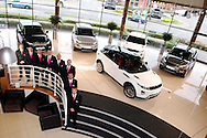 Staff at Hunters Land Rover / Range Rover on Pride Park in Derby are pictured with five vehicles from the brand new Evoque range