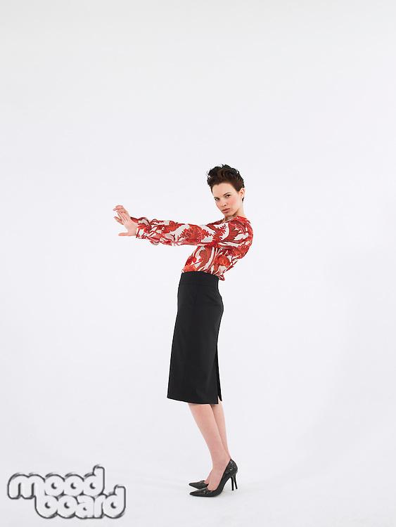 Woman posing in studio full length