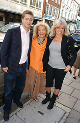 Left to right, TYRONE WOOD, RACHEL KARSLAKE and JO WOOD at a private view of artist Damian Elwes work 'Artists Studios' held at Scream, 34 Bruton Street, London W1 on 29th June 2006.<br />